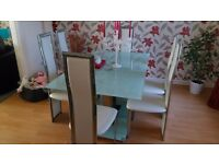 6 seater table and chairs.....never bern used a d in immaculate condition still with tags on