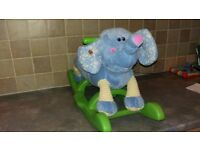 Toddlers sit on rocking elephant with musical ear