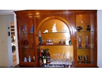 Cocktail display cabinet in two units with glass shelves.