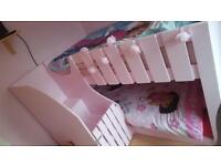 Pink wooden bunk beds