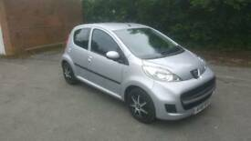 Peugeot 107 1.0 4 door silver 2011 30 a year tax