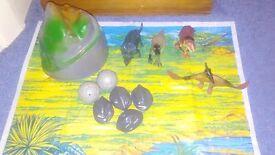 Childrens dinosaur toy set. 4 dinosaurs/mat/mountain/boulders