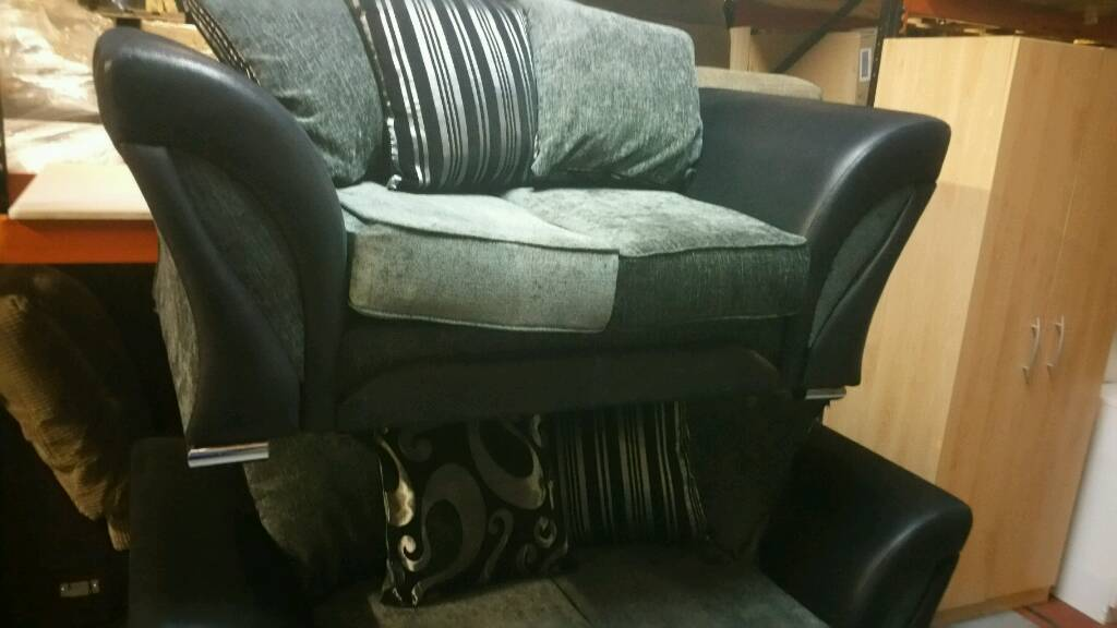 A few months old like new stylish silver grey fabric xblack suide effect 3x2 sofas.