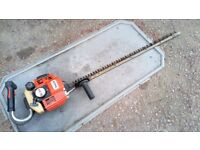 Sthil petrol hedge trimmer , long single sided blade .