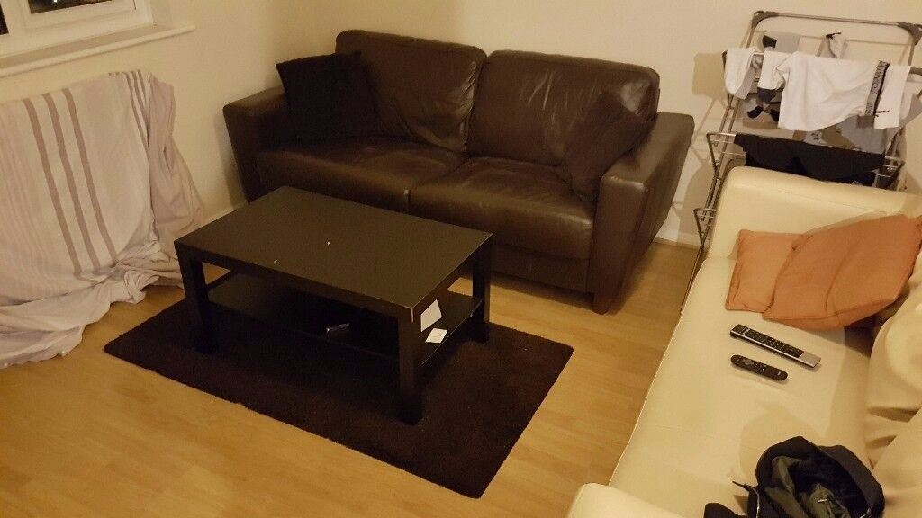 Brown Leather Look Sofa comes with free Coffee Table & Rug
