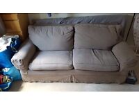 Light brown / taupe 3 seater sofa bed.
