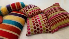 5 beautiful feather cushions. Very good condition. Velvet stripes and spots. Vibrant colours.
