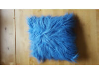 Ideal for childrens room. Blue fluffy cushion. £1