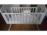 Wooden rocking crib with mattress
