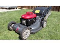 Self propelled lawn mower .
