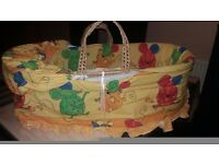 Moses Basket with a Colourful Interior