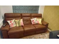 Reclining tan leather sofa