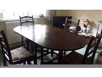 Dark wood extendable dining table and 4 matching chairs