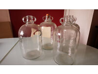 Four Demijohn bottles