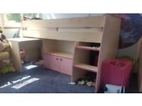Girls bed with storage cupboard and desk underneath bed