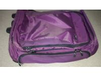 4 pieces of luggage in good condition. 2 large holdall style cases with wheels and 2 medium holdalls