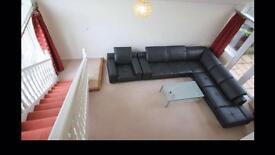 Black corner sofa - brand new condition