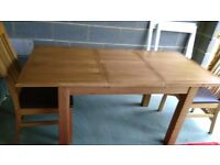 Extending oak table and 4 M&S oak/brown leather chairs, great condition