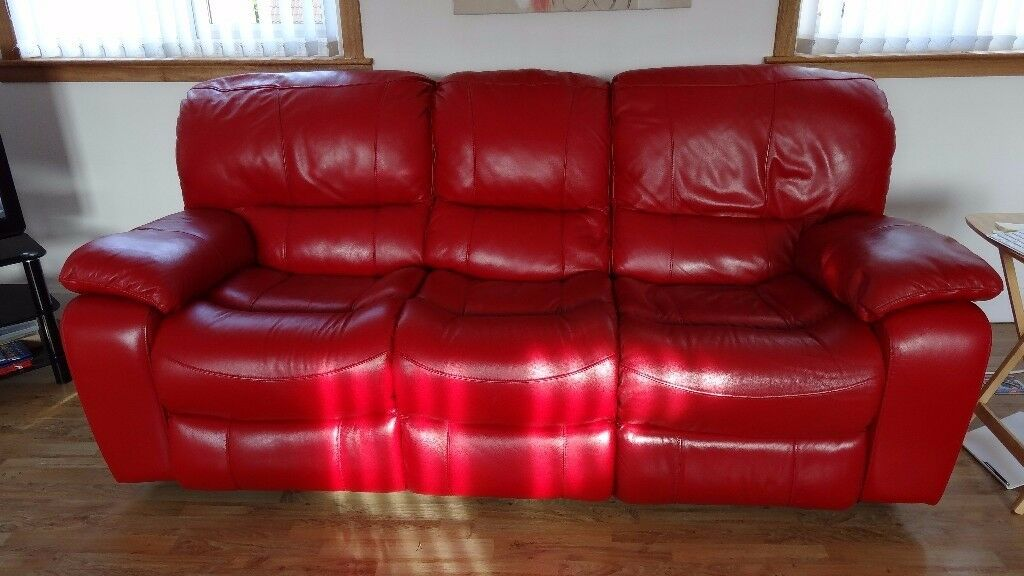 Leather suite, two three seater red leather recliners