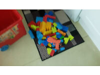 LARGE COLLECTION OF MEGA BLOCKS IN DIFFERENT SHAPES AND SIZES WITH TOYBOX