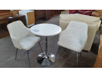 lLovely dining table with 2 leather cream chairs