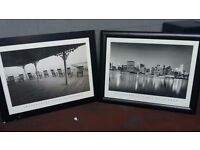 Two large black and white prints. Delivery can be arranged if required.