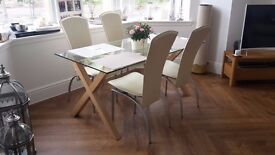 4 beautiful cream faux leather chairs