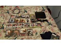 Ps3 slim console, 2 controllers, 20 games