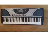 Yamaha Piano Keyboard (61 Touch Sensitive Keys)