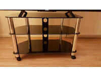 BLACK GLASS TV STAND with Lockable Black Castor Wheels (even for 60 inch TV)
