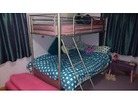 Silver metal bunk bed, pink futon double sofa bed and single mattress top bunk