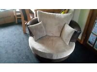 CUDDLE SWIVEL CHAIR NEW CONDITION