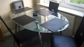 Glass&chrome dining table & chairs. £80.