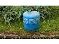 Campingaz. Gas cylinder with an amount of gas.