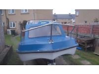 16 ft dory cabin cruiser, 20 hp Honda outboard, with road trailer