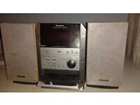 Panasonic CD Stereo system (SA-PM19), multi-CD player, cassette player and radio.