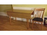 foldable table and three chairs
