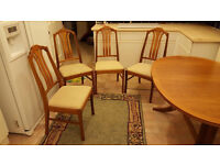 Solid Hard Wood Extendable dining room table & 4 chairs