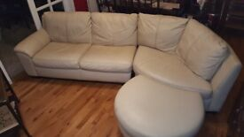 Cream soft leather corner settee in good condition complete with pouffe