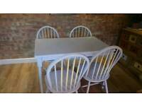 Table with 4 stools for sale