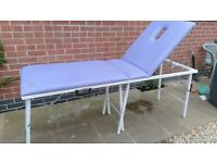 Massage table, lilac colour