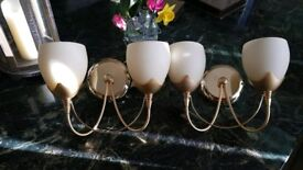 X2 wall lights gold with cream shades