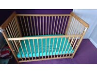 Baby cot bed with waterproof mattress