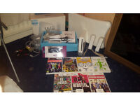 Nintendo Wii Boxed Bundle (2 x Official Wii Controllers, Wii Fit, Nunchuck, Sensor, 7 Games)