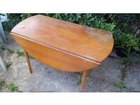 Drop leaf table vintage mid century. Some damage to be fixed