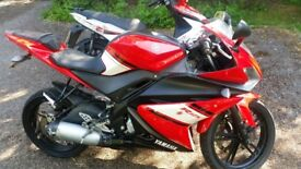 Yamaha yzf r125 and a kymco super8 125