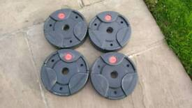 4 x weight plates/discs.Weight lifting
