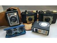 Collection of vintage cameras, flash and cases