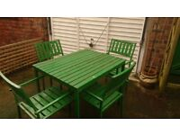 garden table and chairs, wood and metal, weatherworn but usable. Free