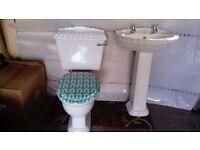 white toilet and wash basin